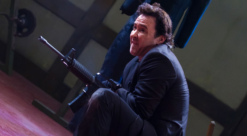John-Cusack-with-gun-in-The-Carrier