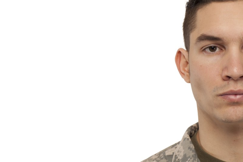 Cropped face of soldier against white background