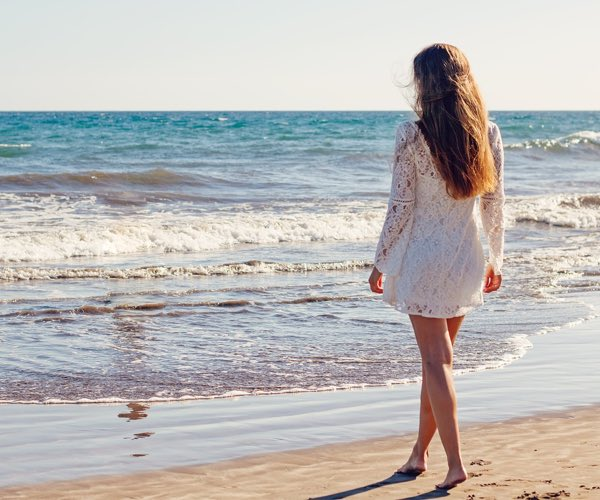 woman on beach in sundress